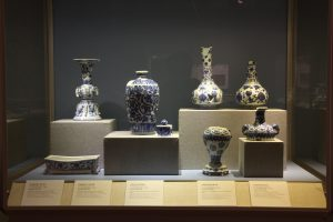Blue and white vases in a glass case